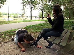 Playing with her slave in a public place was a real thrill