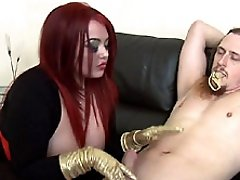 Mistress Jemstone pulls hard on Merlins cock to make him cum