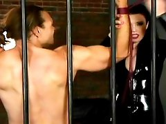 Brunette domina restrains male slave, clamps his nipples and starts training him