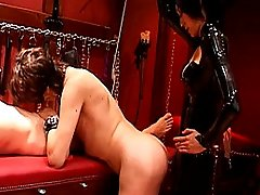 Asian domina practices electric cbt and orders submissive woman to suck mature male slave`s dick