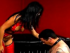 Severe asian domina pins slave`s tongue then whips and clamps his small dick and nuts