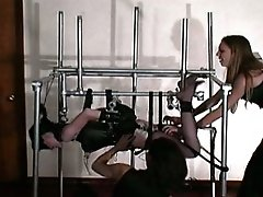 A female  slave gets her nipples pinched, gets spanked and electric-shocked, and gets tickled