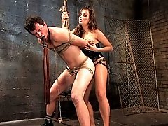 Hot bitch dominatrix flogs and fucks dogboy