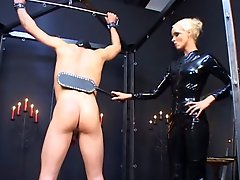 Blonde German Mistress fucks her male slave with a strapon cock